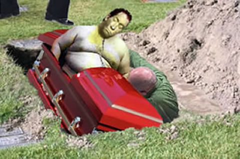 Sumo man falling out of casket